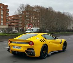 Ferrari F12 TDF painted in Giallo Tristrato   Photo taken by: @488talk on Instagram
