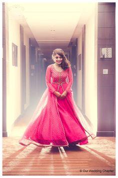 Bride Sugandhika decked up in a hot pink jacket lehenga. Gotta love a shy shot like this one!