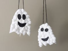 DIY these hanging puffy ghosts with cotton balls on white construction paper. Glue on black paper eyes and mouths in expressions of your choosing.