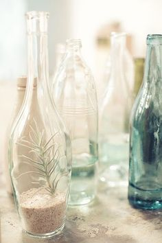 sand- cool idea for table decor, recycled bottles with sand and other things inside