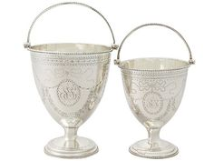 'Sugar Baskets in Georgian Sterling Silver' http://www.acsilver.co.uk/shop/pc/Pair-of-Sterling-Silver-Sugar-Baskets-Antique-George-III-67p7714.htm