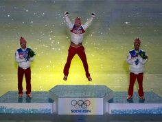 Sochi 2014 - Closing Ceremony (L-R) Silver medalist Maxim Vylegzhanin of Russia, gold medalist Alexander Legkov of Russia and bronze medalist Ilia Chernousov of Russia celebrate in the medal ceremony for the Men's 50 km Mass Start Free