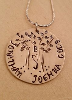 Alodie  Blossom Designs~ handcrafted jewelry  (Sold on Etsy).  Tree of life, family tree. This precious little hand stamped tree is adorned with the initials of Dad and Mom on the trunk and the names of their children around the tree.  Unique and custom orders gladly accepted. Help design your own jewelry. Message me on Etsy. : )
