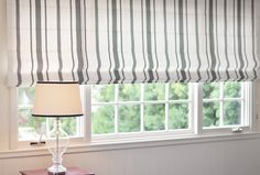 Custom Roman Shade by DrapeStyle.  Made to order in your choice of over 200 fabrics.  We make each shade in our own Studio with your choice of lining and hardware.    #romanshade
