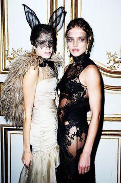 Elena Perminova and Natalia Perminova wear statement gowns with lace accessories
