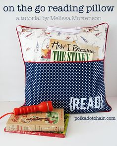 Tutorial for a pillow for kids complete with a pocket for books and a handle to carry it.