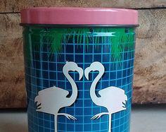 1980's pink flamingo tin canister palm trees 80's grid
