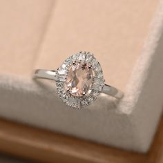 Morganite engagement ring, oval cut morganite, sterling silver, pink gemstone by LuoJewelry on Etsy https://www.etsy.com/listing/465325497/morganite-engagement-ring-oval-cut