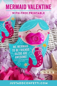 "Let's shell-ebrate! This ""We Mermaid To Be Friends Kazoo Are Awesome!"" Kids Valentine free printable is so fun! It's easy to assemble too. All you need is the mermaid free printable as well as lip kazoos, scissors and an xacto knife. I found the lip kazoos at Dollar Tree in a 6-pack for $1. Perfect for classroom valentines or Valentine's Day party favors! #kidsvalentine #kidsvalentines #classroomvalentines #JustAddConfetti #valentines #diyvalentines"