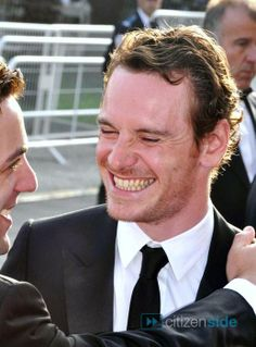 When Fassbender smiles he really smiles.  He laughs.