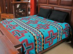 "Our Luxury Southwest Bedspreads feature new El Paso Saddleblanket designs in vibrant, classic Southwest colors.   Made from high quality acrylic, they incorporate a fine weave and a double-ply heavyweight material.   Imported.  Done in a Turquoise Cross design.   KING SIZE 114"" X 96"""