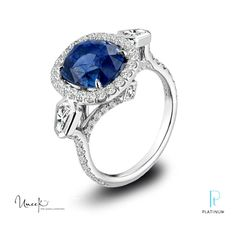 Uneek Fine Jewelry platinum and diamond ring featuring a cushion sapphire surrounded by diamonds.