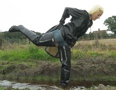 Blonde in thigh waders in water