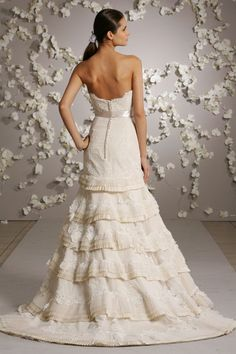 Ivory Victorian lace A-line formal bridal gown, sweetheart neckline, elongated torso with satin bow ribbon belt at natural waist, pleated bias bands with lace applique accent skirt and chapel train. Available in Ivory and White