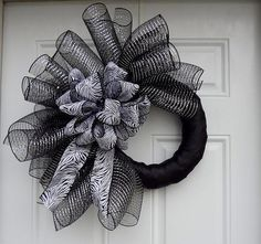 Black Metallic & Silver Elegant Zebra Print Mesh Wreath... Imagine that with a few fake spiders dangling from it. We could always add some orange or purple to it as well