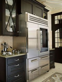 #Kitchen of the Week: This luxury two-tone kitchen features dark walnut and antique white cabinetry, twin panelized refrigerators, a double oven, a large island sink, and a magnificent wood hood... Photo # 63 in Traditional Two-Tone Kitchens (Kitchen-Design-Id...)