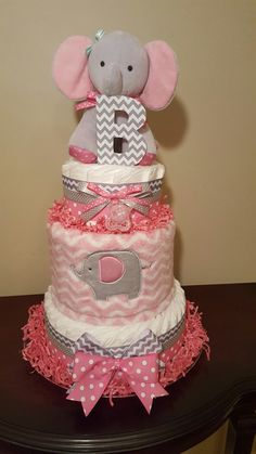 Sweet pink elephant diaper cake. It's a girl! Check out my Facebook page Simply Showers for more pics and orders. https://m.facebook.com/adorablegifts