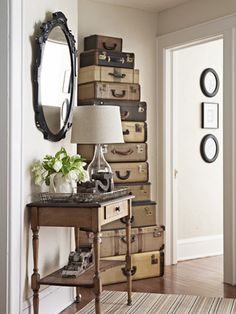 Storage on Display - Stacked up, vintage suitcases can make a statement piece in a hallway or any room. You can use a gorgeous grouping as extra storage as well.