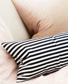 Create a no-sew pillow cover for any size pillow from old bed sheets in under 30 minutes! This simple tutorial shows you how.