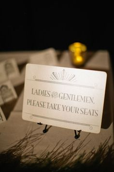 theatre inspired escort card signage