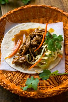 NYT Cooking: This recipe uses a mixture of hoisin and fish sauces as braising liquid, and is a riff on an old Corinne Trang recipe for wok-fried rib tips. It results in a vaguely Vietnamese tangle of pulled pork that is best accompanied by a bright and crunchy slaw, and served on warm flour tortillas that recall the soft pliancy of Chinese bao. Cooking time will vary depending on the slow cooker you're using, but generally the meat begins to fall apart nicely in the neighborhood of 5 to 7 ho...