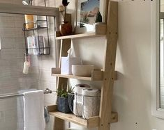 This listing is for an over-the-toilet ladder shelf. Its a great space saver. We do have some Dark Walnut stained ladder shelves that ship within 1 business day that you can view here: Rope Ladder, Rustic Ladder, Ladder Decor, Rustic Wood, Wooden Ladder, Cubby Shelves, Rope Shelves, Shelving, Ladder Bookshelf