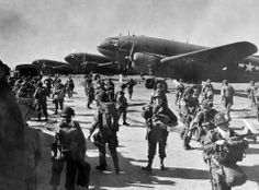 Today is the 69th anniversary of Operation Varsity - The crossing of the Rhine river where the largest airborne operation was conducted in one day at one location. The objective was to gain a foothold over Germany's largest natural barrier, the Rhine river. This photograph depicts elements of the 513th PIR, 17th Airborne Division preparing to board C-46's from the 48th TCS 313th TCG at Achiet Airfield, France.