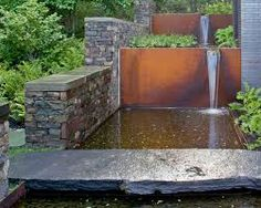 Image result for water feature in retaining wall