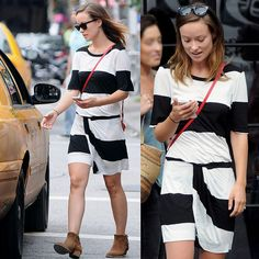Olivia Wilde wearing a striped dress with rugged ankle boots in New York City on August 2, 2013