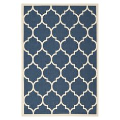 Anchor your patio seating group or define space in the den with this loomed indoor/outdoor rug, featuring a quatrefoil-inspired trellis motif for eye-catchin...
