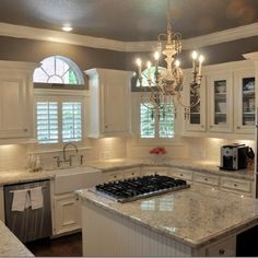 White cabinets, grey ish walls, light counters.
