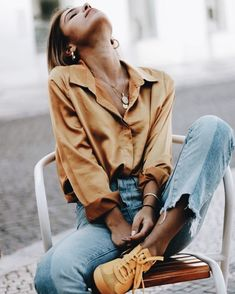 A simple shirt and dainty golden necklaces make a perfect spring combo