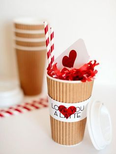 """Coffee is on you this Valentine's Day! Use this adorable presentation idea to give your besties a gift card for their next cup of coffee. Download and print our cup wrapper design that reads """"Love You a Latte."""" Then, attach to a paper coffee cup. Fill with tissue paper or paper shreds, and add the gift card and a few cute straws."""