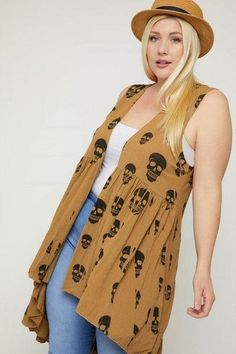 Made In U.S.A 1XL.2XL.3XL Sleeveless cardigan featuring a long flattering silhouette, a rounded pleated hemline, and a skull sublimation print. 33% Rayon 63% Polyester 3% Spandex Tan POL Sleeveless Cardigan Featuring A Long Flattering Silhouette Silhouette, Sleeveless Cardigan, Bronze, Slim Fit Pants, Plus Size Tops, V Neck Tops, Hemline, Spandex, Plus Size Fashion
