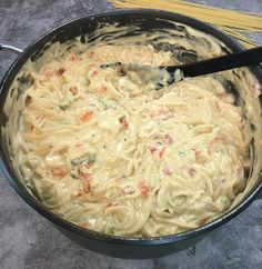 Creamy chicken spaghetti made with rotisserie chicken, Rotel tomatoes, Velveeta Cheese, and cream of mushroom and cream of chicken soups. This easy chicken spaghetti recipe is ready in 30 minutes. This is serious comfort food! Chicken Spaghetti Casserole, Chicken Spaghetti Recipes, Spaghetti Salad, Chicken Soups, Baked Spaghetti, Creamy Chicken, Rotisserie Chicken, Chicken Recipes, Recipes With Velveeta Cheese