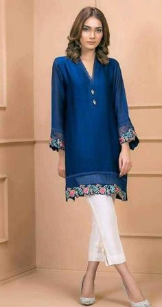 Color: Blue Fabric: Raw silk Work Details: Embroidered PRODUCT DETAILS Demetria is a navy blue cotton net shirt embellished with embroidery on the daman and sleeve cuffs with buttons on the neckline. Pakistani Fashion Casual, Pakistani Dresses Casual, Pakistani Dress Design, Indian Fashion, Pakistani Couture, Stylish Dress Designs, Stylish Dresses, Women's Fashion Dresses, Casual Dresses
