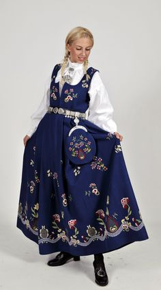 "Blue ""Grafferbunad"" with embroidered waist and skirt from Lom, Gudbrandsdalen, Oppland, Norway (I don't think the belt is originally a part of this bunad. The bunad also have a hat, but the model doesn't wear it) Folk Clothing, Historical Clothing, Traditional Fashion, Traditional Dresses, Norwegian Clothing, Frozen Costume, Ethnic Dress, Medieval Dress, Folk Costume"
