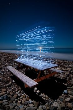 electric picnic table on dark rocky beach (repinned by https://www.fujidirekt.de/fotoleinwand )