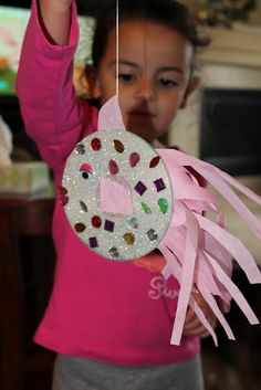 Create a fun fish with a CD and some tissue paper.