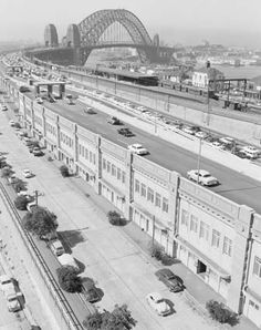 Sydney Harbour Bridge from the Northern end showing the toll gates and the traffic lanes on the Eastern side, 1960. Photographer: W. Brindle. NAA: A1200, L34106