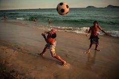 David Alan Harvey. BRAZIL. Rio de Janeiro, RJ. 2010. Men play soccer on the beach. David Alan Harvey, Play Soccer, Magnum Photos, Brazil, Running, Beach, Photography, Men, Rio De Janeiro