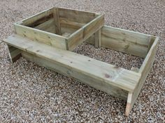 split level raised bed with attached bench seat. The partition allows you to seperate different crops, and the attached bench is perfect for sitting on while tending to your vegetables. Ideal for the elderly or infirm. #raisedbeds #gardenbench