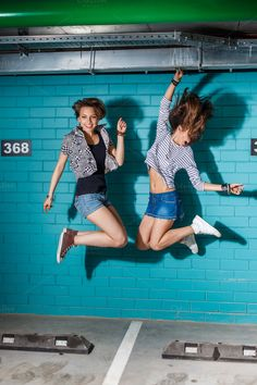 Young people jump and have fun. by nikkolia on @creativemarket. Price $8 #younggirljumpstockphoto #hipsterstockphoto #lifestylebloggerstockphoto