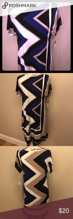 NWT patterned short sleeve dress NWT patterned short sleeve dress. Blue, tan, off-white and black pattern. Lined. Would look great with belt and booties! Studio One Dresses