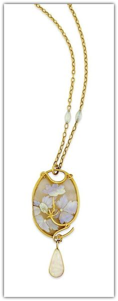 RENÉ LALIQUE | AN ART NOUVEAU GLASS AND OPAL PENDANT. The oval glass panel with engraved floral detailing and applied carved opal flowerheads raised on a sinuous gold stem, to the similarly designed frame, suspending a single opal drop terminal, to the belcher-link chain with two barrel shaped opal accents, circa 1900.
