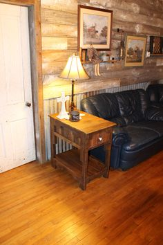 recycled pallet side table- check out the bottom wall with metal and pallet boards on the walls................