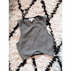 Urban Outfitters crop top Crop top. Never worn. Xxxs. You have to be very small! I'm an xs and couldn't get it on. Urban Outfitters Tops Crop Tops
