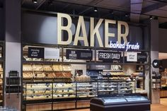 """Much of the design input was directed in creating the 'urban market', making it the heart of the store and main service node. This was anchored by a """"wine cellar"""" to direct the shopper through the store into this market space. Bakery Shop Design, Retail Store Design, Cafe Design, Restaurant Design, Bakery Store, Bakery Display, Convinience Store, Bread Display, Supermarket"""