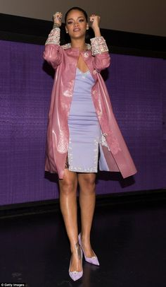 Worth celebrating: Rihanna donned the beaded PVC coat over a tight lilac dress which she t...