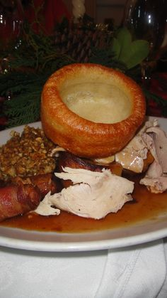 Traditional British Christmas meal: roast turkey, stuffing, sausage wrapped in bacon, Yorkshire pudding, roast potatoes, gravy